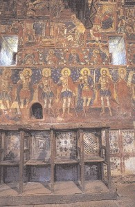 a view of the interior of the catholic revealing the frescoed wealth that extends to the smallest niche of the temple.