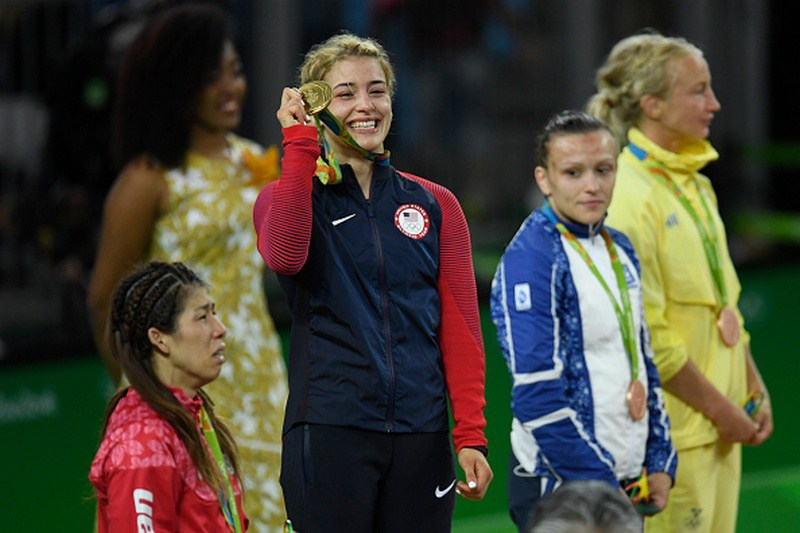 RIO DE JANEIRO, BRAZIL - AUGUST 18: Helen Maroulis of the United States accepts her gold medal after defeating Saori Yoshida of Japan during the medals ceremony for 53kg women's freestyle wrestling on Thursday, August 18, 2016. Maroulis defeated Yoshida 4-1 to capture the gold. Yoshida is the world's most decorated wrestler with three Olympic gold medals and 13 world titles. (Photo by AAron Ontiveroz/The Denver Post via Getty Images)